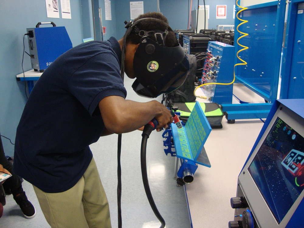 Photo of Student in a welding simulator